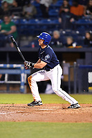 Asheville Tourists designated hitter Vince Fernandez (8) swings at a pitch during a game against the Greensboro Grasshoppers at McCormick Field on April 27, 2017 in Asheville, North Carolina. The Tourists defeated the Grasshoppers 8-5. (Tony Farlow/Four Seam Images)