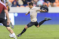 Houston, TX - Friday December 9, 2016: Steven Echevarria (15) of the Wake Forest Demon Deacons takes a shot at the Denver Pioneers goal at the NCAA Men's Soccer Semifinals at BBVA Compass Stadium in Houston Texas.