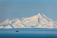 Marine vessel travels through cook inlet. mount iliamna volcano, Aleutian mountain range, Alaska Peninsula, southcentral, Alaska.