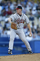 Damian Moss of the Atlanta Braves pitches during a 2002 MLB season game against the Los Angeles Dodgers at Dodger Stadium, in Los Angeles, California. (Larry Goren/Four Seam Images)