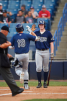 Tim Elko (right) of Hillsborough High School in Lutz, Florida high fives Alex Toral (19) of West Orange High School in Davie, Florida after hitting a home run playing for the Tampa Bay Rays scout team during the East Coast Pro Showcase on August 3, 2016 at George M. Steinbrenner Field in Tampa, Florida.  (Mike Janes/Four Seam Images)
