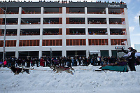 Emily Maxwell runs down 4th avenue during the ceremonial start of the 2019 Iditarod in downtown Anchorage, Alaska on Saturday March 2.<br /> <br /> Photo by Jeff Schultz/  (C) 2019  ALL RIGHTS RESERVED