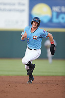 Josh Jung (15) of the Hickory Crawdads hustles towards third base against the Charleston RiverDogs at L.P. Frans Stadium on August 10, 2019 in Hickory, North Carolina. The RiverDogs defeated the Crawdads 10-9. (Brian Westerholt/Four Seam Images)