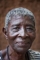 Nigeria. Enugu State. Enugu. Town center. Portrait of an elderly woman at home. Enugu is the capital of Enugu State, located in southeastern Nigeria. 4.07.19 © 2019 Didier Ruef