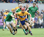 John Conlon of Clare in action against Ritchie English of Limerick during their Munster championship game in Ennis. Photograph by John Kelly.