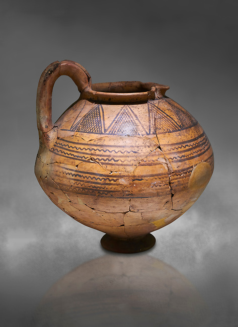 Phrygian terra cotta jug with geometric designs from Gordion. Phrygian Collection, 8th century BC - Museum of Anatolian Civilisations Ankara. Turkey.  Against a grey background