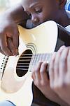 USA, Illinois, Metamora, Fathers and son (6-7) playing guitar