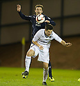 Dundee's Kevin McBride goes into the back of Raith Rovers' Liam Fox.