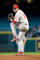 Philadelphia Phillies pitcher Roy Halladay #34 winds up during the Major League Baseball game against the Houston Astros at Minute Maid Park in Houston, Texas on September 14, 2011. Philadelphia defeated Houston 1-0 to clinch a playoff berth.  (Andrew Woolley/Four Seam Images)