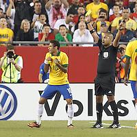 Yellow Card: Brazil forward Neymar (10) from Juan Guzman. In an international friendly, Brazil (yellow/blue) defeated Portugal (red), 3-1, at Gillette Stadium on September 10, 2013.