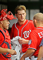 22 July 2012: Washington Nationals pitcher Ross Detwiler (center) chats with teammates in the dugout prior to a game against the Atlanta Braves at Nationals Park in Washington, DC. The Nationals defeated the Braves 9-2 to split their 4-game weekend series. Mandatory Credit: Ed Wolfstein Photo