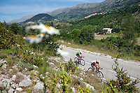 Triathletes on the bike course of Ironman France 2012, Nice, France, 24 June 2012. The village of Coursegoules is in the background.
