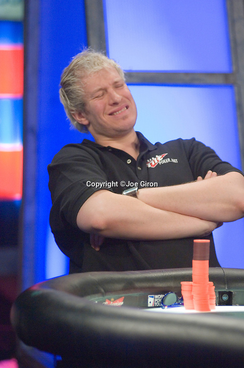Greg Mueller reacts to having to fold after Stern makes a big raise.