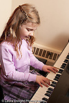 Education Elementary School public private partnership girl in first grade playing the piano
