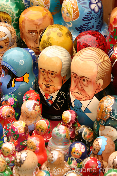 Russian Nesting Dolls depicting  American presidents and cartoon characters on display among traditional designs at a souvenir stand near Checkpoint Charlie, Berlin, Germany