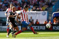 Atletico's Falcao and Granada's Mikel Rico during La Liga BBVA match. April 14, 2013.(ALTERPHOTOS/Alconada)
