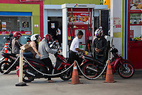 Yogyakarta, Java, Indonesia.  Motorbikes Lining Up for Fuel at Local Gas Station.