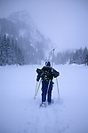 A man snowshoeing in the backcountry of Colorado in Rocky Mountain National Park during a winter storm