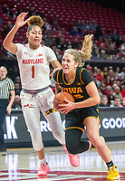 COLLEGE PARK, MD - FEBRUARY 13: Logan Cook #23 of Iowa drives past Shakira Austin #1 of Maryland during a game between Iowa and Maryland at Xfinity Center on February 13, 2020 in College Park, Maryland.