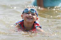 Drake Rodriguez, 6, of Fort Smith plays, Saturday, July 31, 2021 at the lake at Horseshoe Bend Campground in Rogers. Check out nwaonline.com/210801Daily/ for today's photo gallery. <br /> (NWA Democrat-Gazette/Charlie Kaijo)