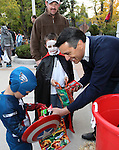 Mike Lannom watches his sons Troy, 6, and Luke, 5, get candy from Gov. Brian Sandoval at the Governor's Mansion in Carson City, Nev. on Wednesday, Oct. 31, 2012. In addition to donations by other local businesses, Kimmie Candy donated 3,000 bags of candy to be handed out to the thousands of trick-or-treaters. .Photo by Cathleen Allison