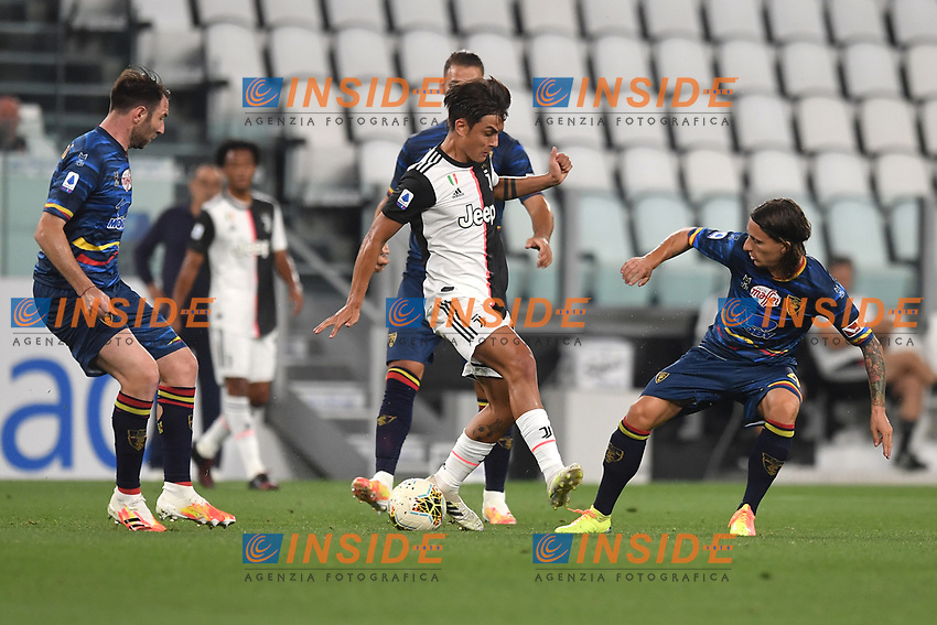 Paulo Dybala of Juventus, Fabio Lucioni and Jacopo Petriccione of Lecce.<br /> during the Serie A football match between Juventus FC and US Lecce at Juventus stadium in Turin  ( Italy ), June 26th, 2020. Play resumes behind closed doors following the outbreak of the coronavirus disease. Photo Andrea Staccioli / Insidefoto