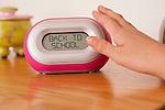 USA, Illinois, Metamora, Child's (10-11) hand pushing alarm clock