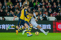Sunday 9th November 2014<br /> Pictured: Jefferson Montero of Swansea City ( right ) is held by Arsenal palyers <br /> Re: Barclays Premier League Swansea City v Arsenal at the Liberty Stadium, Swansea, Wales,UK