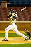 Jack Carey #20 of the Wake Forest Demon Deacons follows through on his swing against the Northwestern Wildcats at Gene Hooks Field on February 26, 2011 in Winston-Salem, North Carolina.  Photo by Brian Westerholt / Four Seam Images