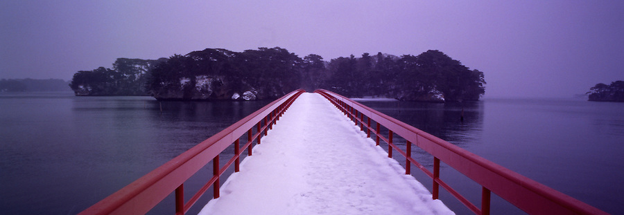 A bridge, in light snow, to one of several offshore islands in Sendai, Japan.  One image from the Hasselblad XPan camera.