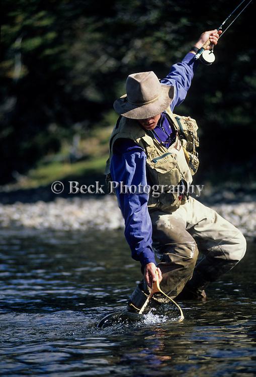 Robert Ramsay landing a trout