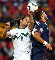 Marko Suler of Slovenia and Clint Dempsey of USA