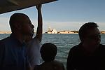 Venice Italy 2009. The church of San Giorgio Maggiore, tourist on a vaporetto waterbus.
