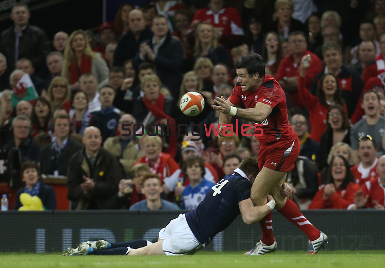 Wales scrum half Mike Phillips looks inside for support as Scotland wing Dougie Fife makes the tackle.<br /> RBS 6 Nations 2014<br /> Wales v Scotland<br /> Millennium Stadium<br /> <br /> 15.03.14<br /> <br /> ©Steve Pope-SPORTINGWALES