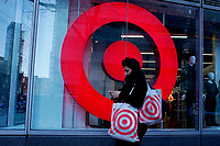 NEW YORK, NEW YORK - MARCH 02: A woman exits Target store on March 02, 2021 in New York. Target hopes to build a growth by investing about $ 4 billion annually for the next years to accelerate the consolidation of new stores, upgrade existing ones and enhance its capacity to fulfill online orders. (Photo by Emaz/VIEWpress)