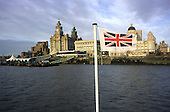 The landmark Liver Building on the Liverpool waterfront seen from the deck of a Mersey ferry