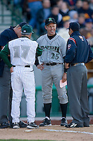Dayton Dragons manager Todd Benzinger #25 shares a laugh at home plate prior to the start of the game versus the Fort Wayne Tin Caps at Parkview Field April 16, 2009 in Fort Wayne, Indiana. (Photo by Brian Westerholt / Four Seam Images)
