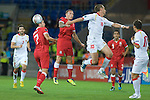 Euro 2012 Qualifying match - Wales v Montenegro at the Cardiff City Stadium..Wales Craig Bellamy challenges Montenegro's Milorad Pekovic to the ball..
