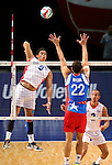 Dominican Republic's Figueroa Adames hits against Puerto Rico blocker Josue Rivera during the Pan American Cup at the Reno Events Center in Reno, Nev., on Monday, Aug. 17, 2015. <br /> Photo by Cathleen Allison