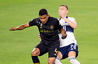 LOS ANGELES, CA - SEPTEMBER 23: Eddie Segura #4 of LAFC collides with David Milinkovic #7 of the Vancouver Whitecaps during a game between Vancouver Whitecaps and Los Angeles FC at Banc of California Stadium on September 23, 2020 in Los Angeles, California.
