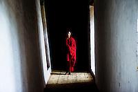 A young Buddhist monk is seen inside the Punakha dzong (fortress) in Punakha, Bhutan.