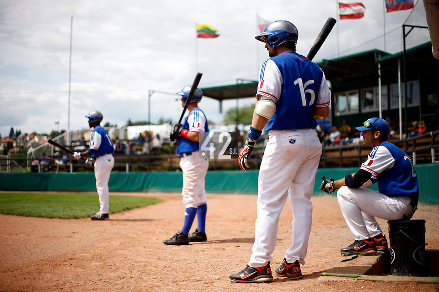 25 June 2011: Felix Brown, Yann Dal Zotto, Florian Peyrichou, Pierrick Le Mestre. Illustration of a photographic essay called Life in the dugout, during Czech Republic 11-1 win over France, at the 2011 Prague Baseball Week, in Prague, Czech Republic.