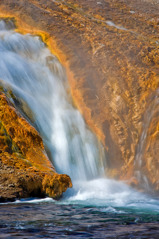 Hot springs waterfall flowing into the Firehole River. Yellostone National Park, WY