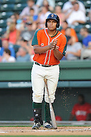 First baseman Josh Naylor (10) of the Greensboro Grasshoppers bats in a game against the Greenville Drive on Thursday, July 14, 2016, at Fluor Field at the West End in Greenville, South Carolina. (Tom Priddy/Four Seam Images)