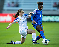 HOUSTON, TX - JANUARY 31: Melchie Dumonay #6 of Haiti takes the ball from Maria Salas #17 of Costa Rica during a game between Haiti and Costa Rica at BBVA Stadium on January 31, 2020 in Houston, Texas.