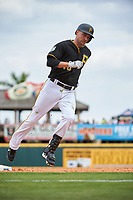 Pittsburgh Pirates shortstop Jordy Mercer (10) rounds the bases after hitting a home run during a Grapefruit League Spring Training game against the New York Yankees on March 6, 2017 at LECOM Park in Bradenton, Florida.  Pittsburgh defeated New York 13-1.  (Mike Janes/Four Seam Images)