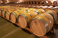 """The new cellar for ageing wine in barrel, rows and rows of oak barriques. Unusually for Bordeaux the barrels are stored """"bond a cote"""" (with the bung hole to the side)  Chateau de Haux Premieres Cotes de Bordeaux  Entre-deux-Mers  Bordeaux Gironde Aquitaine France"""