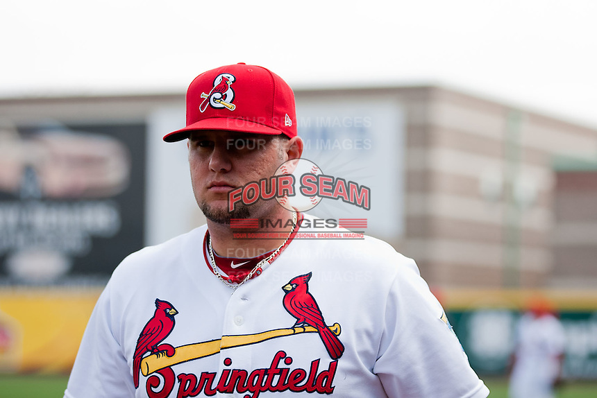 Matthew Adams (25) of the Springfield Cardinals walks toward the dugout prior to a game against the Midland RockHounds on April 18, 2011 at Hammons Field in Springfield, Missouri.  Photo By David Welker/Four Seam Images