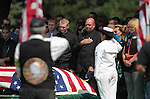 Randy Blunk, center, father of Colorado shooting victim Jonathan Blunk, and his son Dillon, left, were surrounded by hundreds of friends and family at a memorial service for the 26-year-old Navy veteran, in Reno, Nev. on Friday morning, Aug. 3, 2012. (AP Photo/Cathleen Allison)
