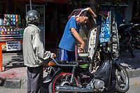 Yogyakarta, Java, Indonesia.  Buying Gasoline by the Liter.